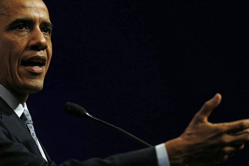 US President Barack Obama will sign into law a Bill passed by Congress to tighten sanctions against Russia over its Ukraine incursion, the White House said on Tuesday amid a dramatic run on the rouble. -- PHOTO: REUTERS