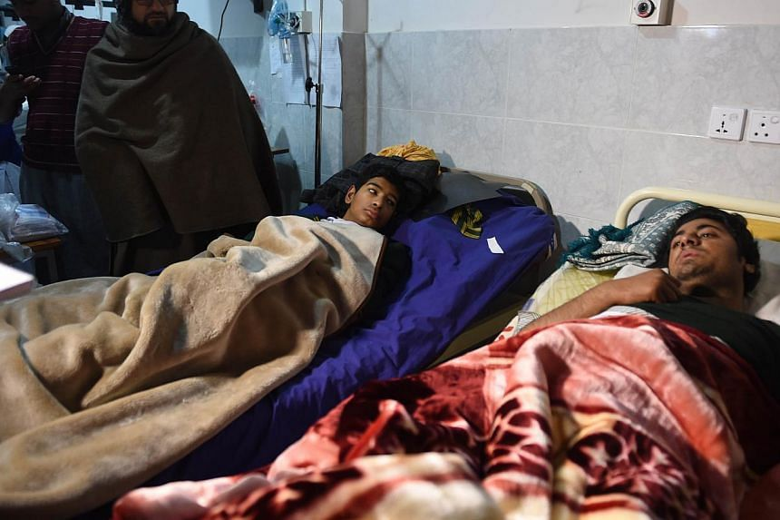 Wounded Pakistanis rest at a hospital after Taleban gunmen attacked a school in Peshawar on Dec 17, 2014.