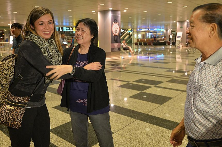 Ms Colleen Turzynski meeting her Singapore relatives - her aunt Lee Say Moi and uncle Lee Tak Nyen - in person for the first time upon her arrival at Changi Airport from the United States early yesterday morning. A visit to her late mother's niche at