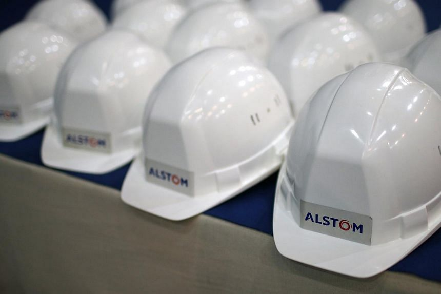 French industrial giant Alstom has agreed to pay US$700 million (S$911 million) to settle US corruption charges related to bribes in Indonesia and other countries, a person familiar with the matter said Tuesday. -- PHOTO: REUTERS