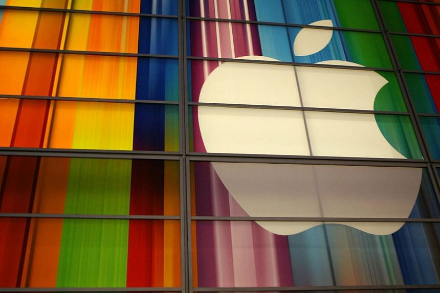 A US jury on Tuesday found in Apple's favour in a US$350 million (S$455 million) lawsuit that accused the tech giant of illegally forcing iPod users to purchase their music on its iTunes service. -- PHOTO: AFP