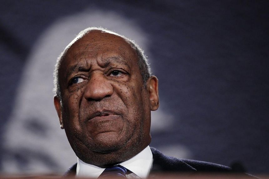 One of Bill Cosby's daughters on Tuesday defended the comedian (above) against allegations from more than a dozen women that The Cosby Show star had sexually abused them decades ago. -- PHOTO: REUTERS