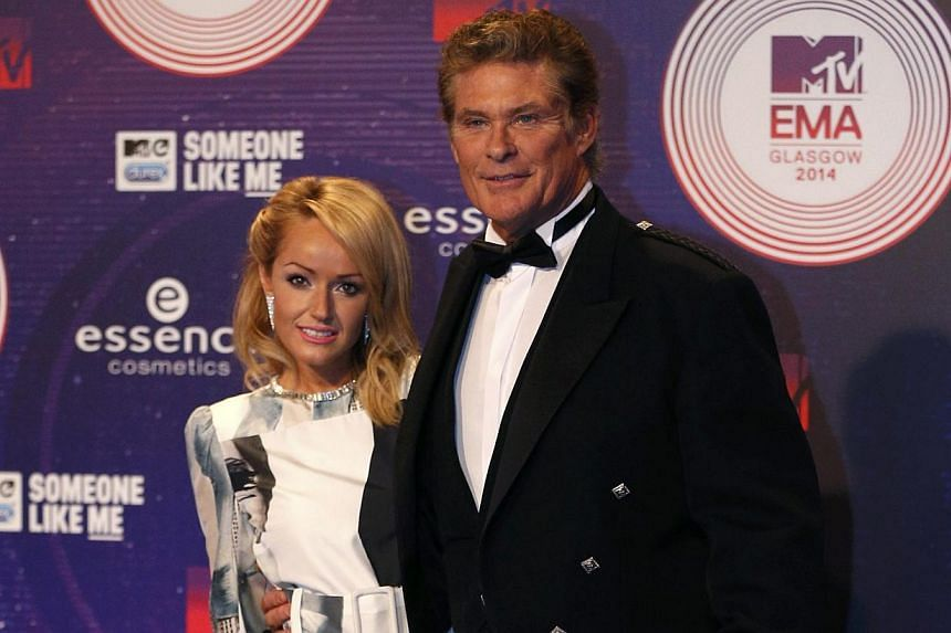 Actor David Hasselhoff and wife Hayley Roberts at the 2014 MTV Europe Music Awards in Scotland on Nov 9, 2014. Baywatch star Hasselhoff will join a massive open air New Year's Eve concert in Berlin at the iconic spot where he famously sang for freedo