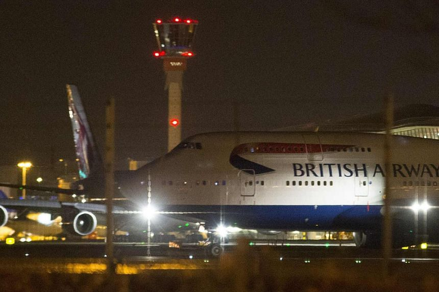 Aircraft taxi next to the control tower at Heathrow airport in London, Dec 12, 2014. London police stopped a plane on the runway at Heathrow Airport to remove a 15-year-old girl intent on joining Islamist fighters in Syria, a report said Wednesd