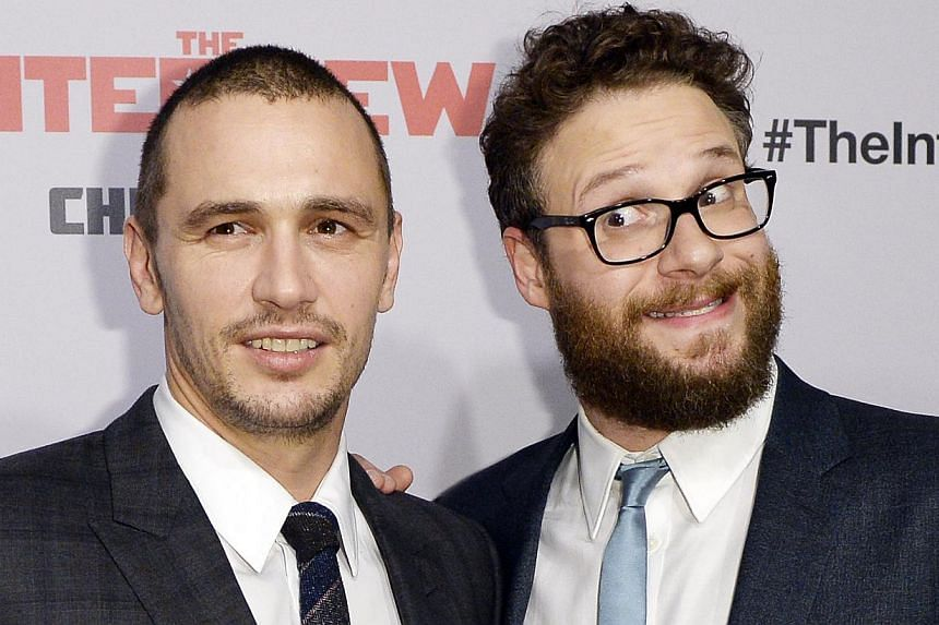 Cast members James Franco (left) and Seth Rogen (right) pose during premiere of the film The Interview in Los Angeles, California on Dec 11, 2014. -- PHOTO: REUTERS