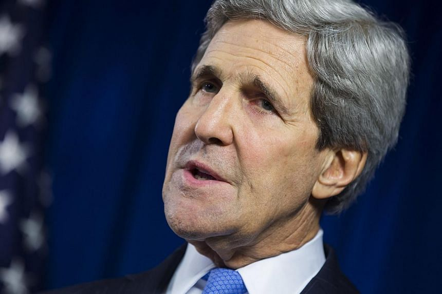 US Secretary of State John Kerry delivers remarks during a news conference at the US Embassy in London Dec 16, 2014. US and European sanctions against Russia could be lifted within days if President Vladimir Putin made the right choices in Ukraine, t