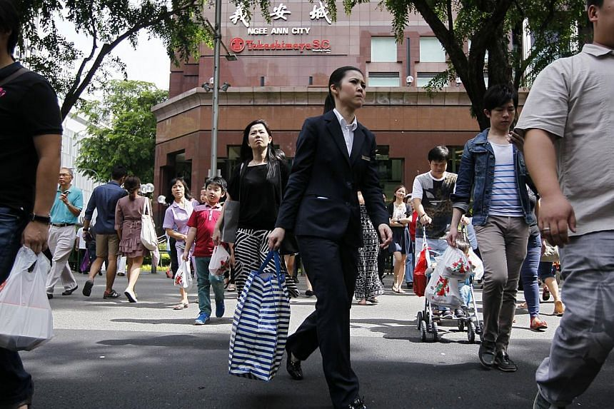 Singapore consumers ended 2014 slightly more optimistic about their finances and the economy, according to a private survey. -- PHOTO: ST FILE