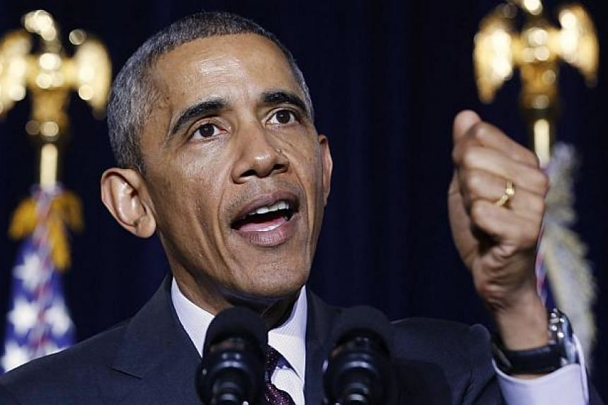 US President Barack Obama (above) was set to announce a shift in policy towards Cuba on Wednesday and the Associated Press reported the changes would include the opening of an embassy in Cuba and the start of talks to normalise relations. -- PHOTO: R