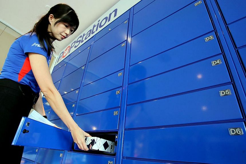 SingPost PopStations allow customers to pick up their parcels round-the-clock from automated kiosks in places such as shopping malls and community clubs. -- PHOTO: LIANHE ZAOBAO