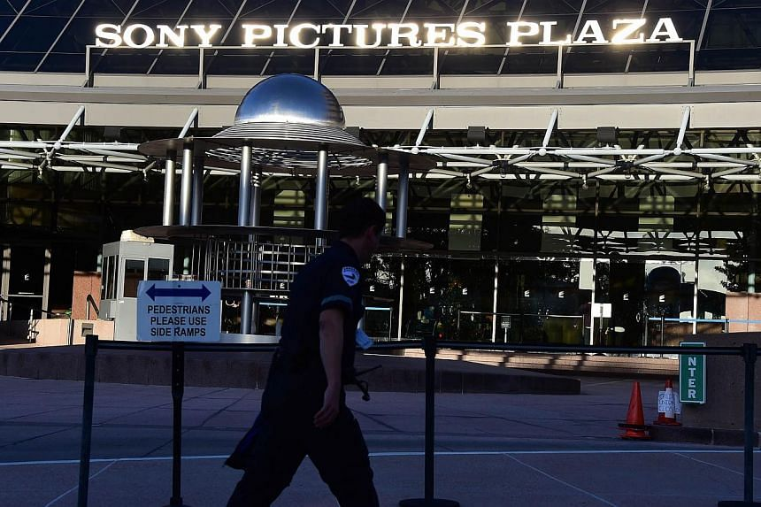 A security guard walks past the entrance to Sony Pictures Plaza in Los Angeles, California earlier this month. -- PHOTO: AFP