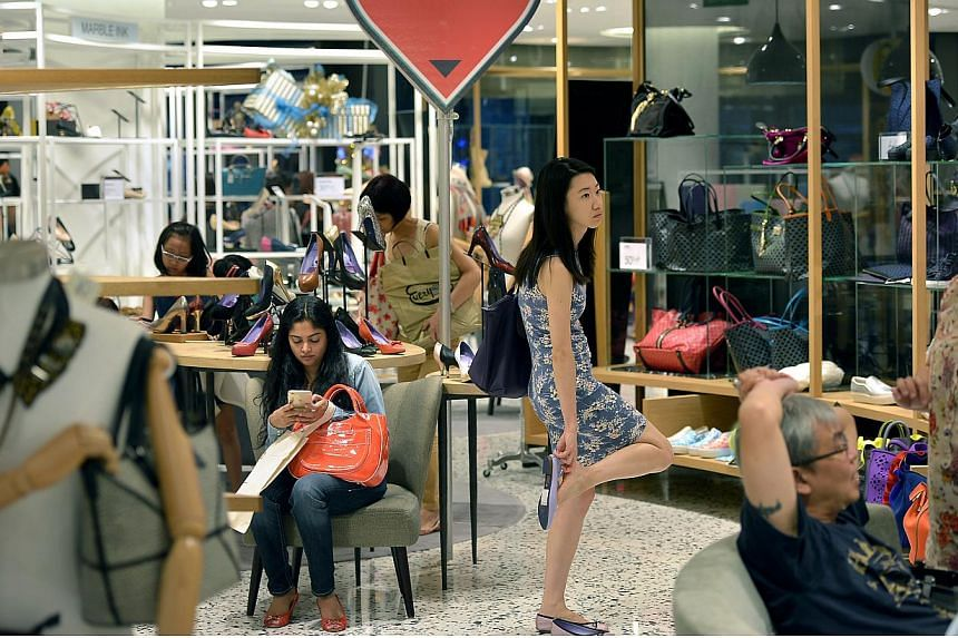 Shoppers at Robinsons at The Heeren in Orchard Road on Nov 28, 2014. Shoppers have tightened their budgets when it comes to buying gifts for the festive season this year, according to a recent survey commissioned by United Overseas Bank Group. -- PHO