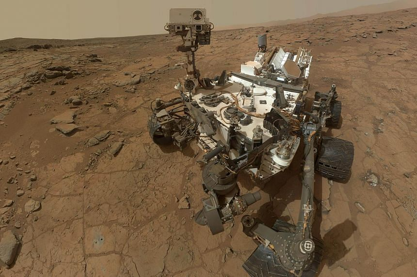 Nasa's Mars rover Curiosity (above, in a composite image) has found carbon-containing compounds in samples drilled out of an ancient rock, the first definitive detection of organics on the surface of Earth's neighbour planet, scientists said on Tuesd