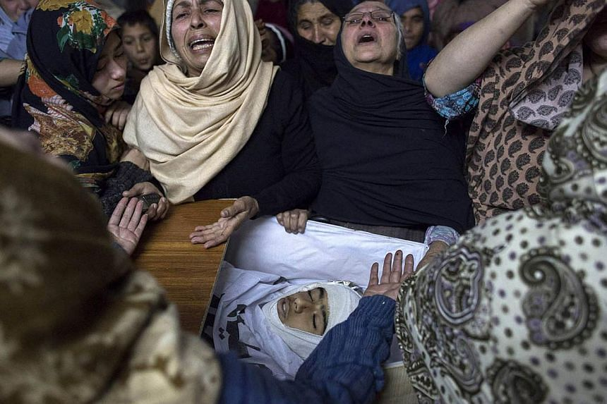 Women mourn their relative Mohammed Ali Khan, 15, a student who was killed during an attack by Taliban gunmen on the Army Public School, at his house in Peshawar December 16, 2014. -- PHOTO: REUTERS
