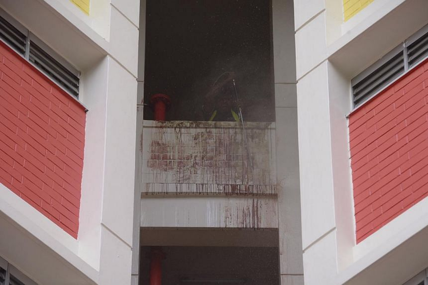 The blood trail,at Blk 505 Tampines Central 1, left by the fleeing suspect. -- ST PHOTO: MARK CHEONG