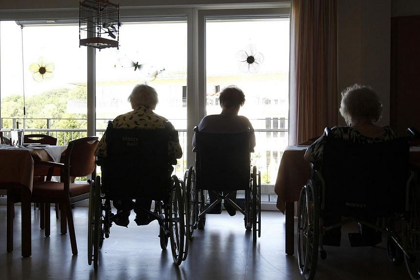 Pensioners in wheelchairs are silhouetted at a residential home for the elderly in Eichenau, near Munich, Germany, in a 201 photo. Health researchers say life expectancy is rising almost everywhere in the world, except southern sub-Saharan Africa. --