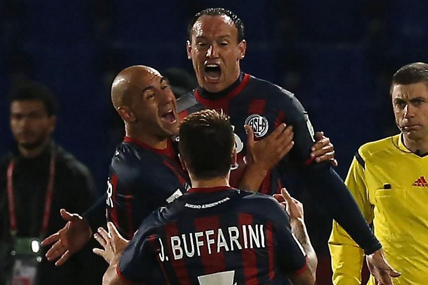 Mauro Matos (centre) of San Lorenzo celebrates with his teammates after scoring a goal against Auckland City during their Club World Cup semi-final soccer match at Marrakech stadium on Dec 17, 2014. -- PHOTO: REUTERS