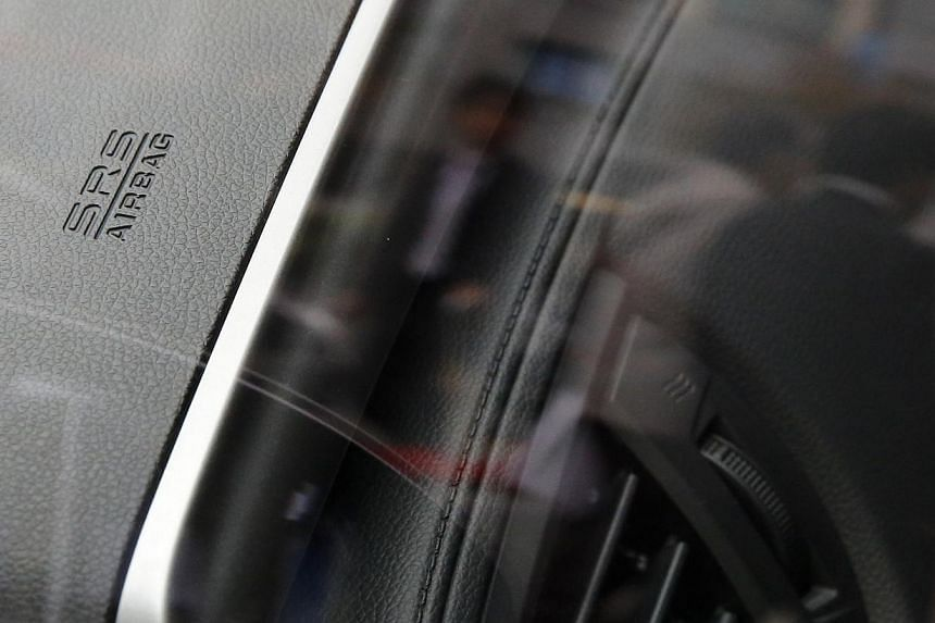 "An airbag logo is seen on a Honda Motor Co's all-new hybrid sedan ""Grace"", which installed the airbag made by Takata Corp, during its unveiling event in Tokyo on Dec 1, 2014. Japanese carmakers are mulling the idea of introducing expiration date"