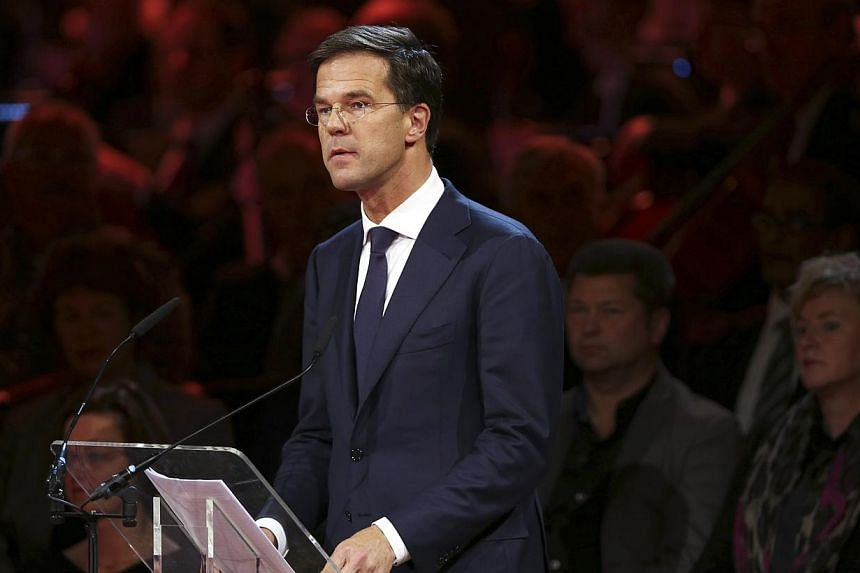 Dutch Prime Minister Mark Rutte makes a speech during a national memorial for the victims of the Malaysian Airlines MH17, at the RAI Convention Centre in Amsterdam on Nov 10, 2014. Mr Rutte cancelled a trip to Brussels, where he was due to take part