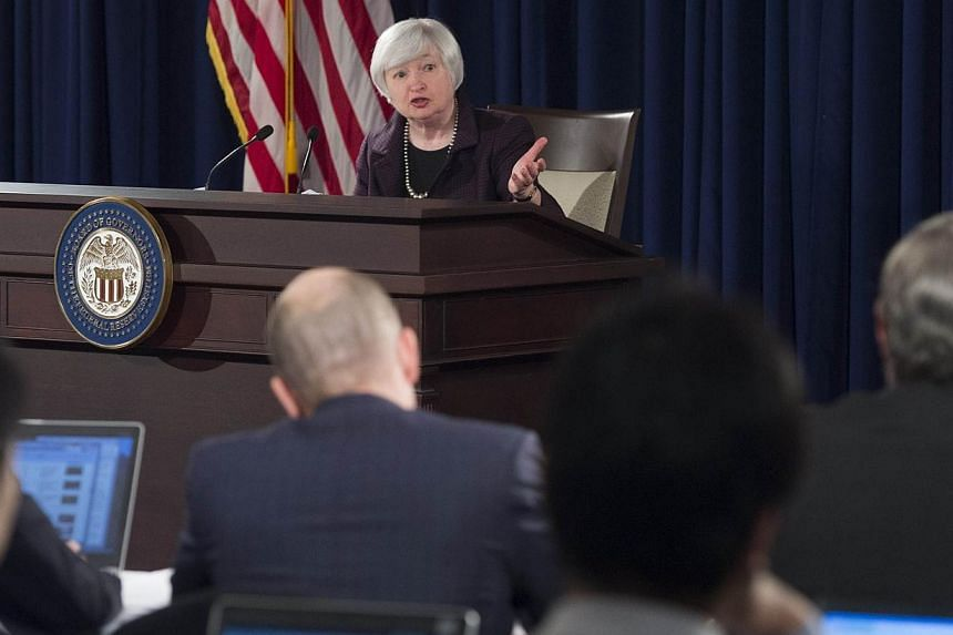 Fed Chair Janet Yellen holds a press conference at the Federal Reserve Board on Dec 17, 2014 in Washington,DC. Since the United States Federal Reserve issued comments on Thursday night about its plans for upcoming monetary policy, analysts and e