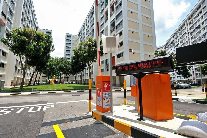 An electronic parking gantry at one of two new carparks in Serangoon. The housing board is ramping up the implementation of the Electronic Parking System (EPS) in HDB carparks, it said in a press release Thursday. -- PHOTO: ST FILE