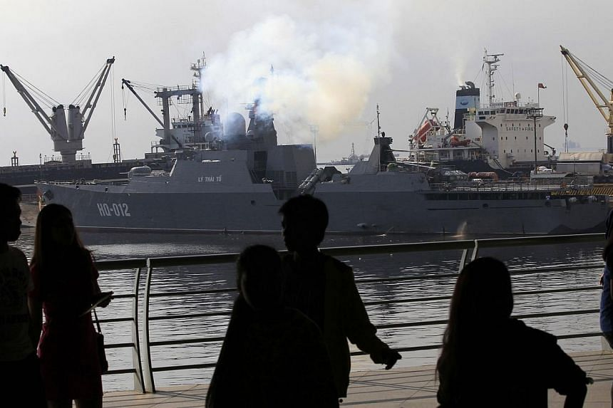 People viewing one of two of Vietnam's Russian-built missile-guided frigates docked at a bay in Manila on Nov 25, 2014. Vietnam's two most powerful warships were making their first port call to the Philippines but an official said it was