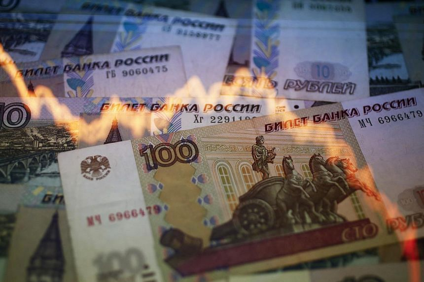 Russia's rouble strengthened on Wednesday after dramatic falls against the US dollar in the previous two days but remained extremely volatile and fears of a prolonged crisis remained. -- PHOTO: REUTERS