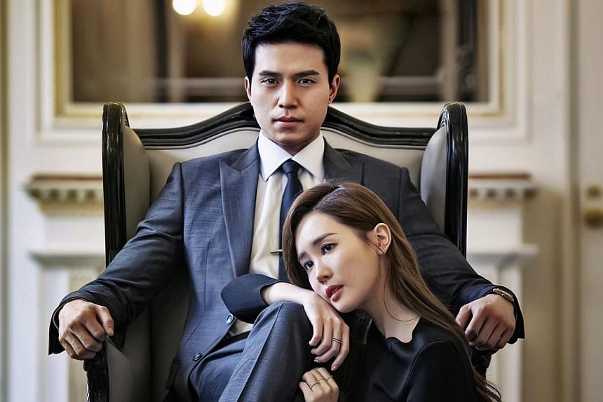 Lee Dong Wook (left) as the hotel manager and Lee Da Hae (right) as the heiress in Hotel King.--PHOTO: OH!K