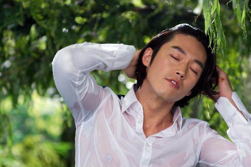 Jang Hyuk, a devoted family man in real life, in current drama You Are My Destiny (above) and in The Slave Hunters, for which he won Best Actor at the Korean Drama Awards.--PHOTO: OH!K