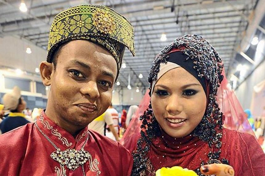 Newlyweds Muhd Muaz Mislan, 15, and Nur Izzati Amiera Ishak, 17, got married late last month in Kluang, Johor. The young couple posted photos and a video of their solemnisation ceremony on Facebook.