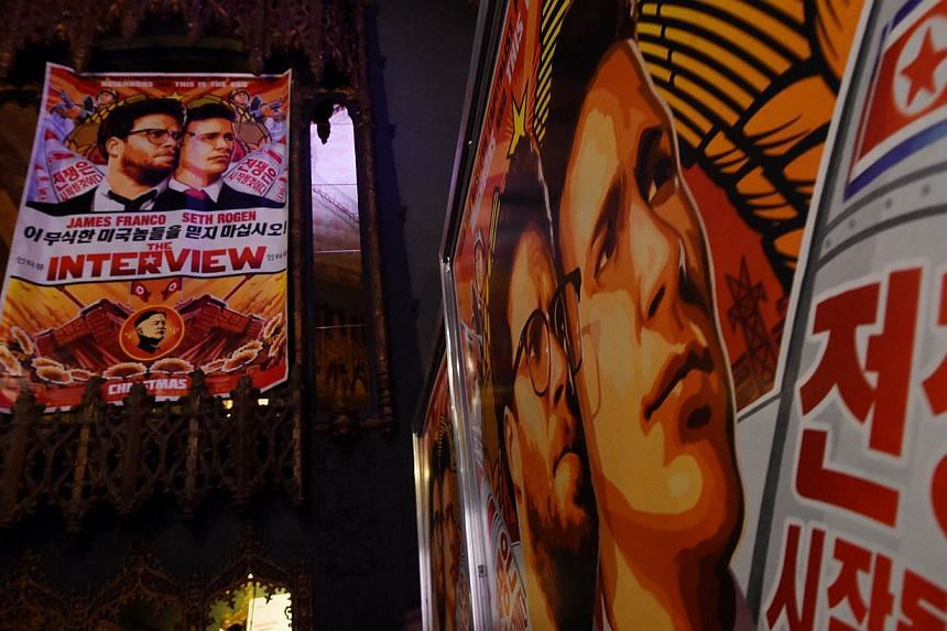 Movie posters for the premiere of the film The Interview at The Theatre at Ace Hotel in Los Angeles, California on Dec 11, 2014. -- PHOTO: AFP
