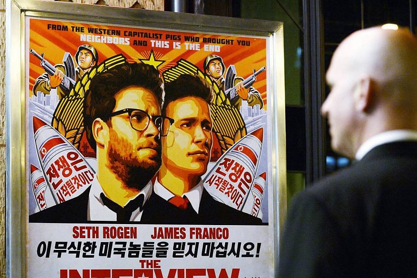 """A security guard stands at the entrance of a theatre during the premiere of The Interview in Los Angeles, California in this Dec 11, 2014 photo. Sony Pictures has """"no further release plans"""" for the parody film that has angered North Korea, after canc"""
