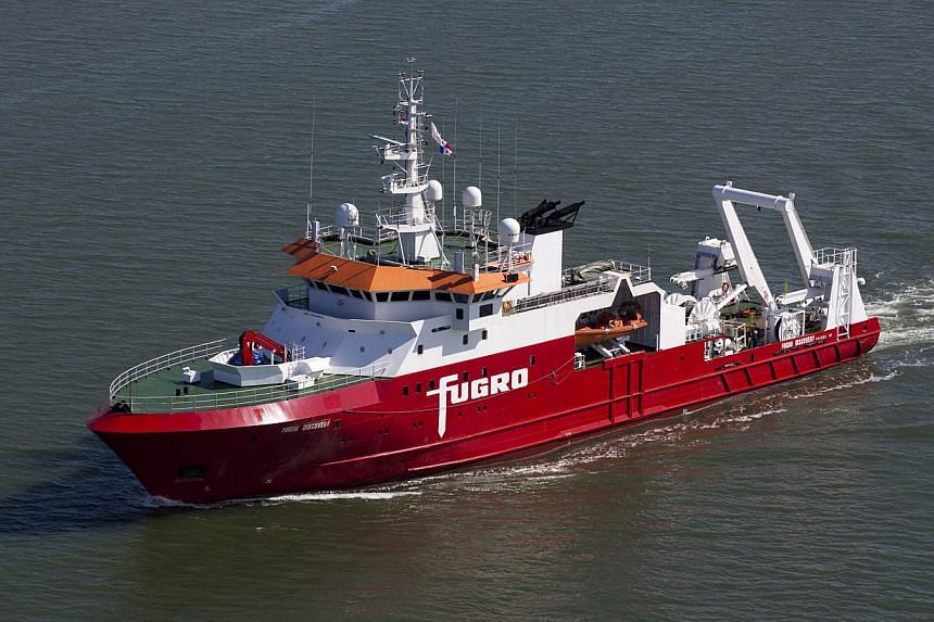 A handout photo obtained on Sept 29, 2014 shows the Australian-contracted survey ship Fugro Discovery, which is involved in the search for the missing Malaysia Airlines flight MH370. -- PHOTO: AFP PHOTO/FUGRO