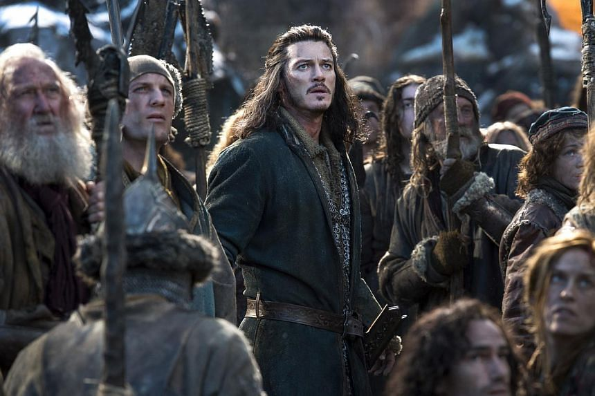 A cinema still from The Hobbit: The Battle Of The Five Armies starring Luke Evans (centre) as Bard the Bowman. -- PHOTO: WARNER BROS