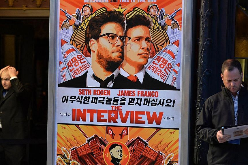 In this Dec 11, 2014 file photo, security is seen outside The Theatre at Ace Hotel before the premiere of the film The Interview in Los Angeles, California. Major US theatre chains pulled out of showing the film following threats from hackers which U