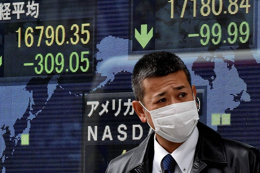 Share prices on display in Tokyo on Dec 16, 2014. Asian shares looked to rally on opening on Thursday after US stocks enjoyed their strongest session this year. -- PHOTO: AFP