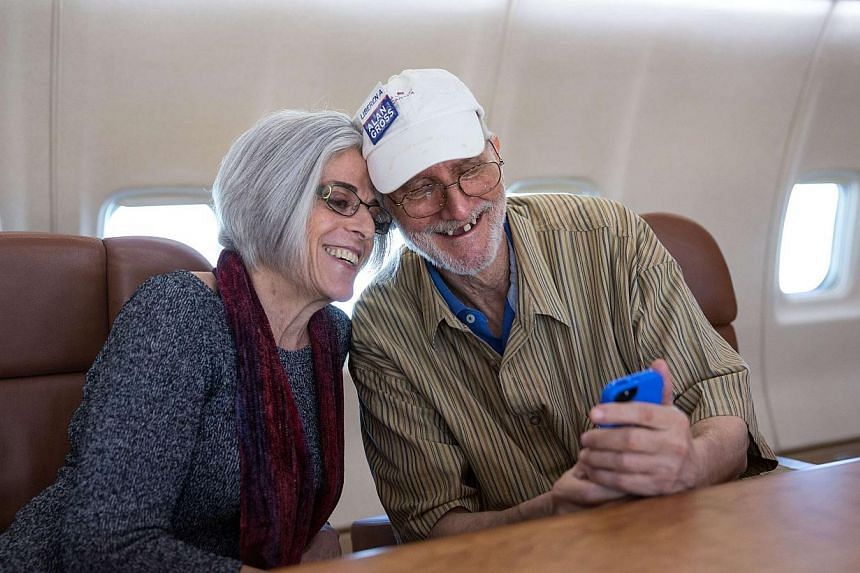 Alan Gross taking a selfie with his wife, Mrs Judy Gross, on board a government plane headed back to the US in this Dec 17, 2014, White House handout photo. -- PHOTO: REUTERS