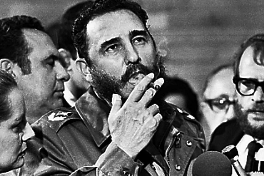 A May 1975 photo showing Mr Fidel Castro smoking a cigar during interviews with the press in Havana during a visit of US Senator Charles McGovern. -- PHOTO: REUTERS