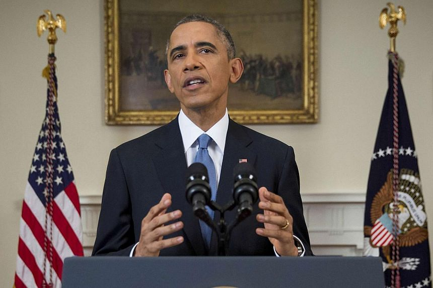 US President Barack Obama announces a shift in policy toward Cuba while delivering an address to the nation from the Cabinet Room of the White House in Washington, Dec 17, 2014.The shift in policy follows Cuba's release of American aid worker Alan Gr