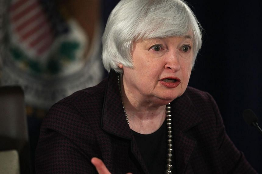 "Federal Reserve Board chairman Janet Yellen speaks during a news conference Dec 17, 2014 in Washington, DC. The US Federal Reserve made no changes to its monetary policy Wednesday, saying it can remain ""patient"" before moving to raise intere"
