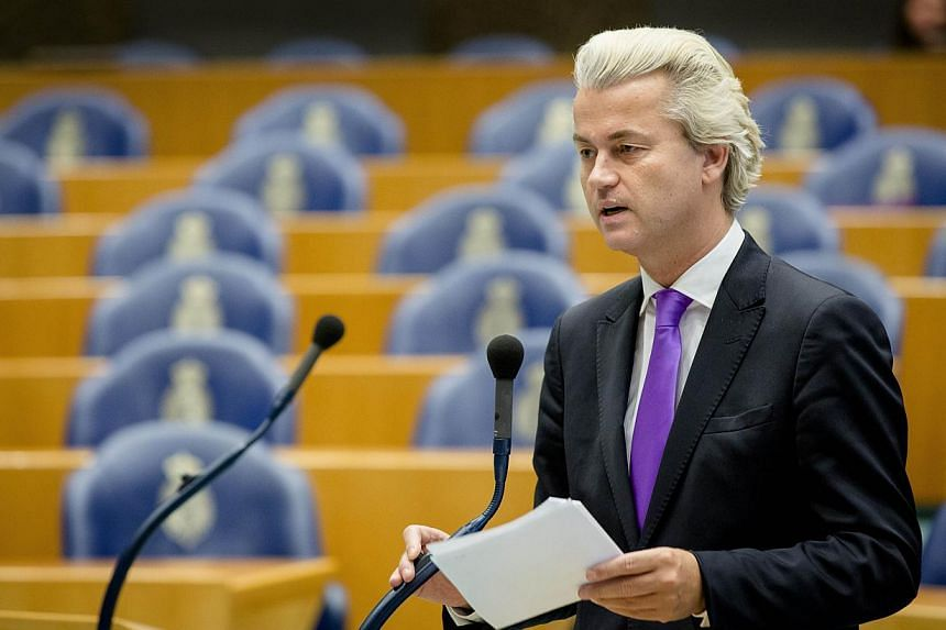"""Dutchfar-right populist lawmaker Geert Wilders speaks in the Parliament Building in The Hague, The Netherlands on Oct 9, 2014. Wilders is be tried for inciting racial hatred after pledging in March to ensure there were """"fewer Moroccans"""" in the"""