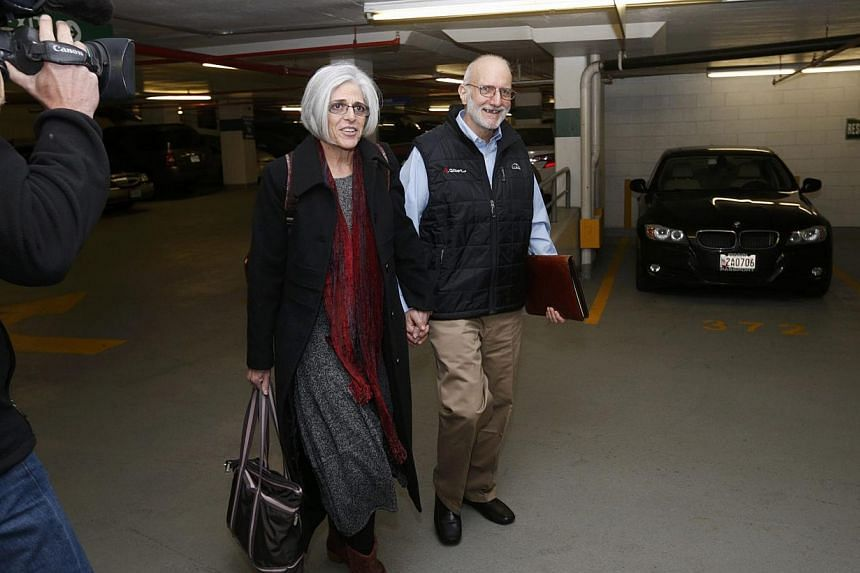 Alan and Judy Gross walk through a parking garage after arriving for a news conference in Washington Dec 17, 2014. Cuba released Alan Gross after five years in prison. -- PHOTO: REUTERS