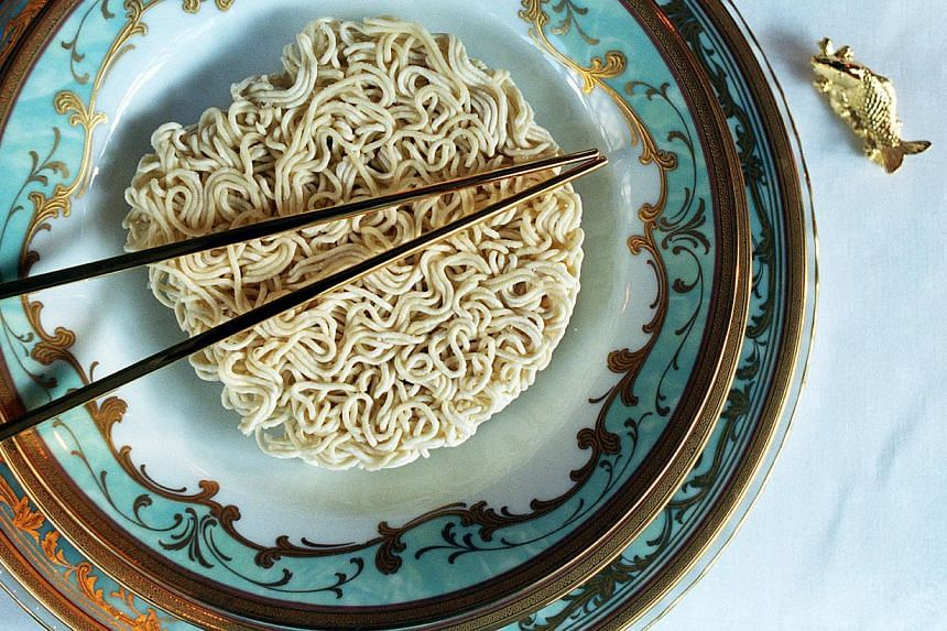 Taiwanese authorities on Thursday ordered a leading food company to recall two flavours of instant noodles over fears they contain a banned dye as the island's latest food scandal deepened. -- PHOTO: ST FILE