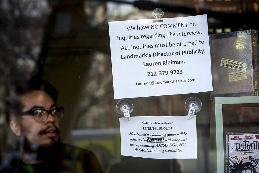 A sign is seen posted on the box office window at the Sunshine Cinema in New York Dec 17, 2014. US cinemas cancelled screenings, including a red-carpet New York premiere, of a madcap comedy that offended North Korea, after mysterious computer ha