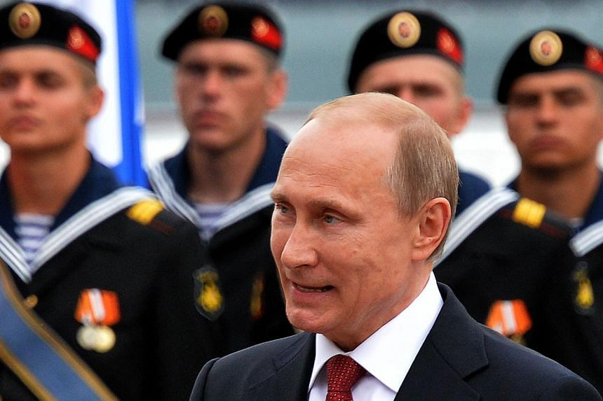 A file picture taken on May 9, 2014 shows Russian President Vladimir Putin as he speaks during his visit to the Crimean port of Sevastopol. -- PHOTO: AFP