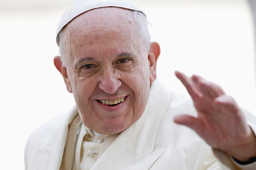 """Pope Francis (above) played a vital role in bringing Cuba and the United States to the negotiating table, making a """"personal appeal"""" to the nations' leaders, a US official said Wednesday. -- PHOTO: REUTERS"""