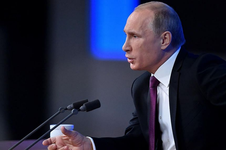 Russian President Vladimir Putin speaks during his annual press conference in Moscow on Dec 18, 2014. -- PHOTO: AFP