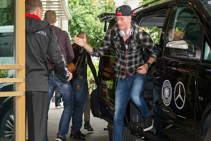 Picture taken on Sept 2, 2013 shows German international Marco Reus getting out of the car as he arrives at the team hotel in Munich, southern Germany. -- PHOTO: AFP