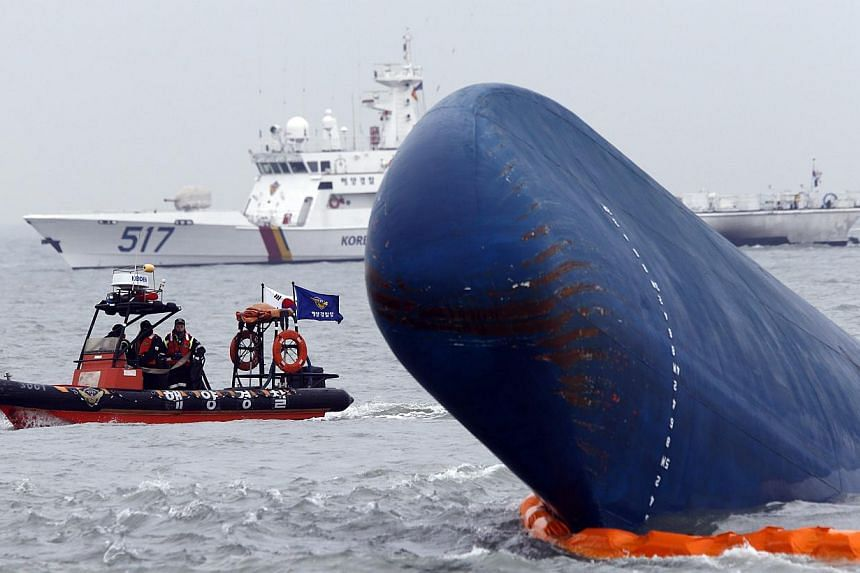 Rescue boats sail around the South Korean passenger ship 'Sewol' which sank, during their rescue operation in the sea off Jindo in this April 17, 2014 file photograph. -- PHOTO: REUTERS