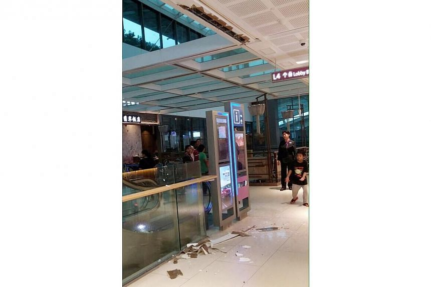 Heavy rain on Wednesday brought down a small section of the ceiling at Westgate. -- PHOTO:CAPITAMALLS ASIA