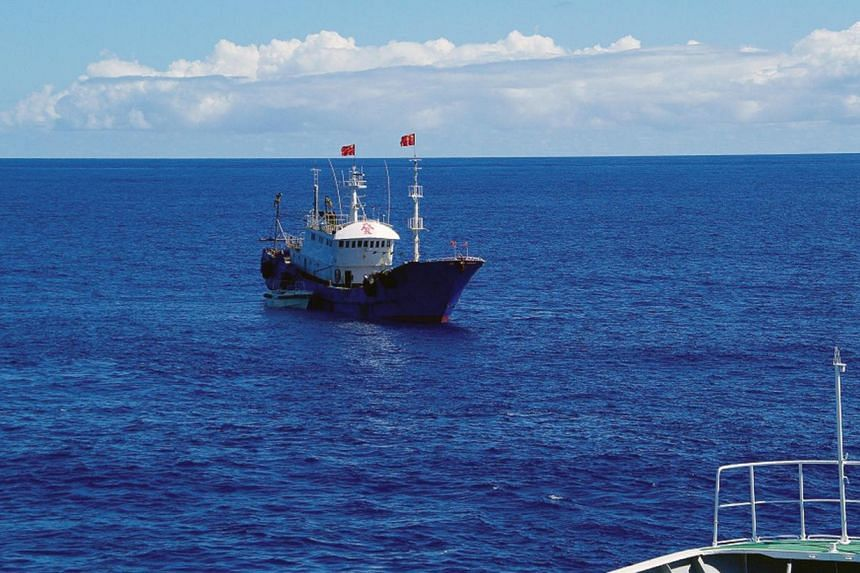 A Chinese fishing boat in Japan's exclusive economic zone near Ogasawara islands, 1,000km south of Tokyo. China will set up an offshore observation network, including satellite and radar stations, to strengthen the country's maritime power, the offic